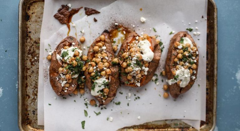 Slow Roasted Sweet Potatoes with Spicy Garlic Chickpeas and Blue Cheese Sauce