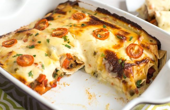 Refried Bean Enchiladas with Jalapeno Cheese Sauce