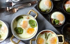 Spicy Baked Eggs with Fiddleheads & Prosciutto